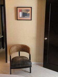 Reading chair in guest bedroom