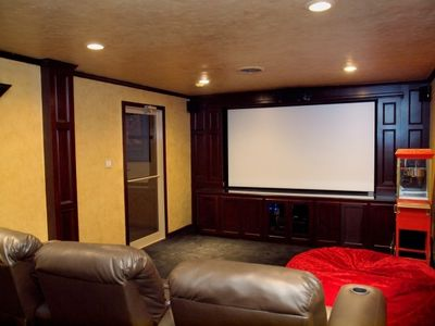 Media Room Recliners to Watch Large Rear Project Theatre Screen