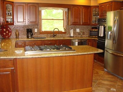 Kitchen with stainless steel appliances and all cooking utensils included.