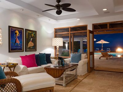 Spacious living area opens to screened porch