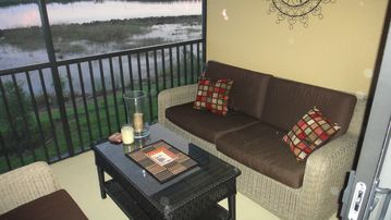Relax on the lanai with lake and golf view!