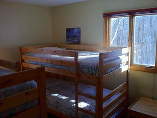 Campton house photo - Lower level bedroom with two sets of bunk beds.