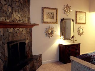 Falmouth estate photo - Master Bath gas stone fireplace.