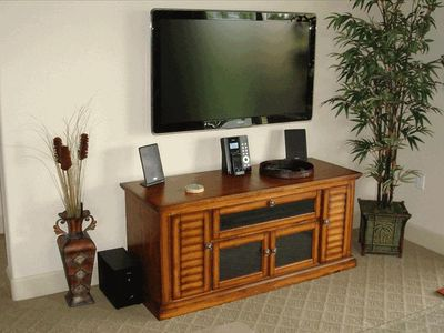 "47"" wall mounted TV, iPod stereo"
