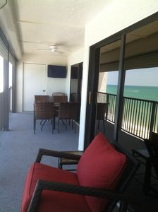 30 foot balcony with comfortable furniture & TV