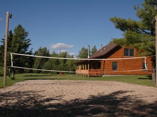 sand volleyball court with lights - Colton cottage vacation rental photo