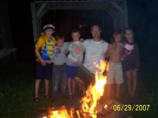 Angola cottage photo - Bond Fire, Smores, and tired kids ready for bed