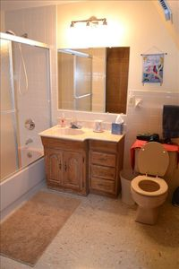 Large bathroom with shower and tub.