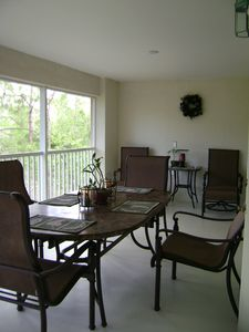 Lanai furniture features granite top and sling style high back seating.