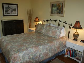 Tybee Island condo photo - The master bedroom--there is a TV in the side bureau.