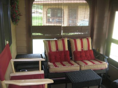 All season porch with a mounted TV