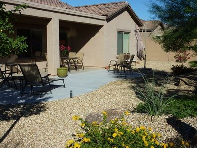 South facing backyard, beautifully landscaped . Perfect for eating and relaxing