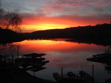 Tulloch Lake house rental - Fire red sunset...every night is another magical vision