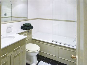 En suite bathroom 2 in sage green with white porcelain tiles