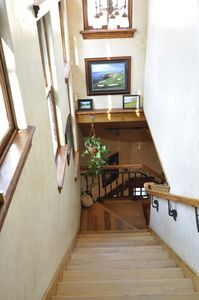 Staircase from garage to Main Floor. This house has an elevator.