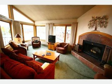 Keystone condo rental - Woodburning fireplace in living area