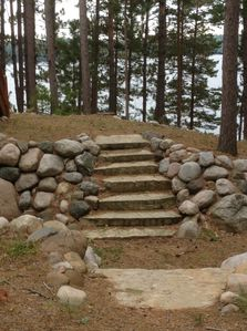 Stone steps leading to basement walkout