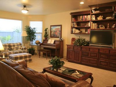 Downstairs Family Room, pool table, air hocky, kitchen, poolside patio & grill