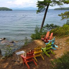 Adirondack chairs on the sandy perch above the lake shore. - Alton house vacation rental photo