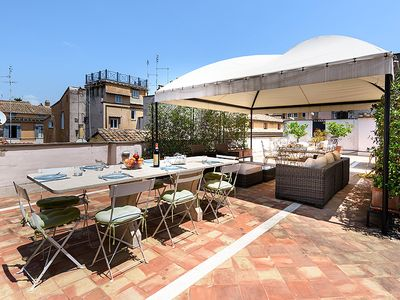 The expansive, elegant, panoramic and furnished terrace: sitting & dining areas.