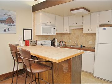 Updated Kitchen with Granite Tile Counters, New Appliances, & New Backsplash.