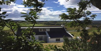 Traditional croft cottage overlooking the Snizort River - Portree, Isle Of Skye.