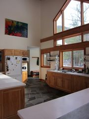 Huletts Landing house photo - Open kitchen with view to bay and dock. Mud room and screen porch.
