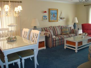 Surfside Beach condo photo - Living and dining area with attractive beach themed decor
