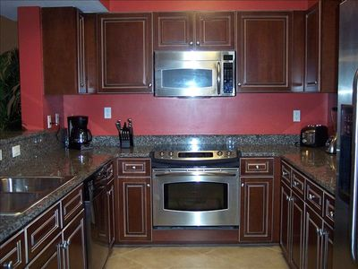 Kitchen has granite counter tops and stainless-steel appliances