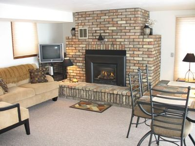 The LakeHouse living room features a gas fireplace and lake view.