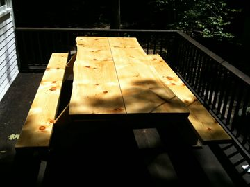 The pine slab picnic table on camp's back porch.