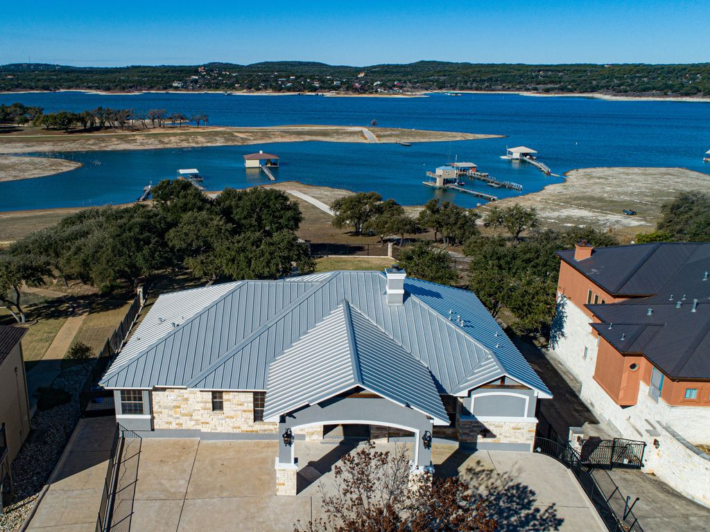 Lakeside retreat with stunning views of Lake Travis and large gameroom!