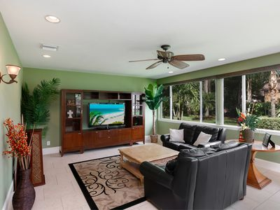 55 inch TV in Florida room. Beautiful view of landscaped yard.
