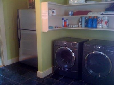 Stainless refrigerator and high efficiency washer/dryer