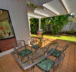 Poipu house photo - Backyard dining table