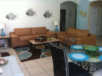 spacious living area with 2 couches, open to the dining and kitchen!