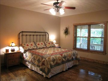 Master bedroom features a king size bed