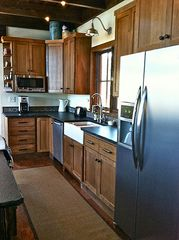 Georgetown Lake house photo - Custom cabinetry, granite counters, stainless appliances and a farmhouse sink.