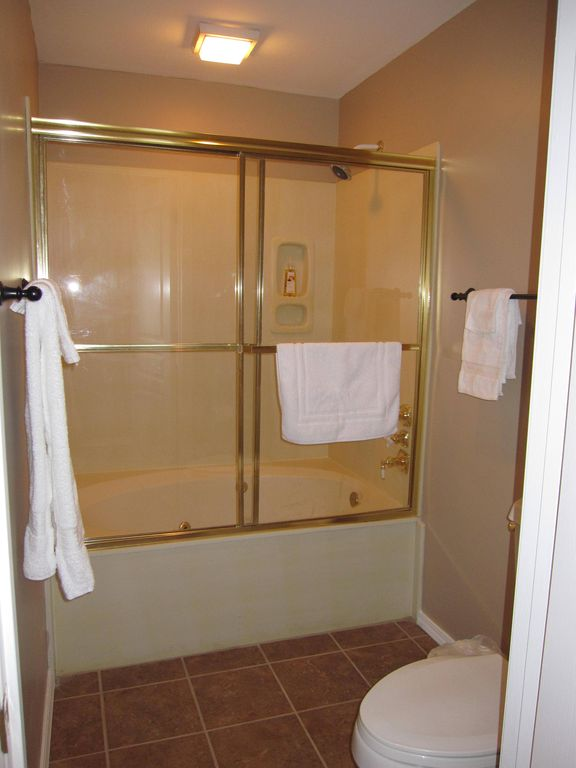 The master bath is an extra deep water fall jetted whirlpool tub.
