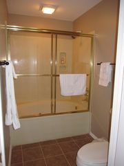 Branson condo photo - The master bath is an extra deep water fall jetted whirlpool tub.