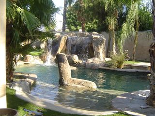 Palm Springs villa photo - Spa inside Cave with slide-tree stump in foregroun