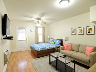 Austin apartment photo - Open floor plan with queen bed, couch, and large 42 inch flat screen tv.