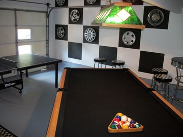 "Game room - a.k.a. ""man-cave"" with flat screen TV and table games"