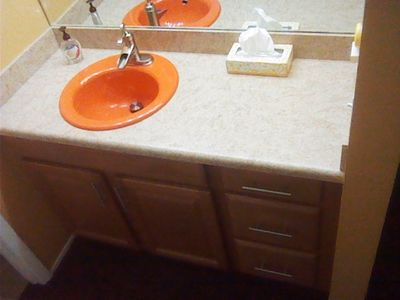 Bathroom vanity, New cabinets, counter top, but we couldn't part with the sink!