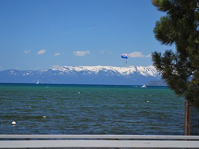 View of Lake Tahoe from deck with snow capped mountains