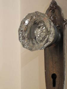 Glass door knobs are just one of the many original touches in the house.