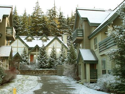 The Snowgoose complex is nestled in the trees at the foot of Blackcomb Mountain.