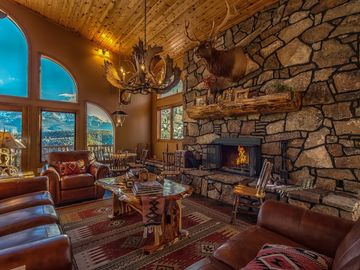 Woodland Park house rental - Great Room with wood ceiling, log accents, slate floors, and Pikes Peak view.