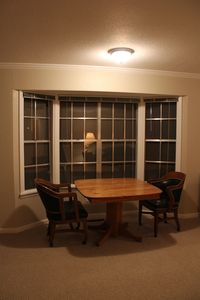 Table and chairs at bay window location.