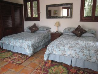Ocean and jungle views from each double bed located off the patio. - Puerto Vallarta house vacation rental photo